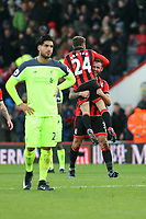 Football - 2016 / 2017 Premier League - AFC Bournemouth vs. Liverpool<br /> <br /> Bournemouth's Steve Cook lifts fellow goalscorer Bournemouth's Ryan Fraser into the air at the final whistle at Dean Court (The Vitality Stadium) Bournemouth<br /> <br /> COLORSPORT/SHAUN BOGGUST