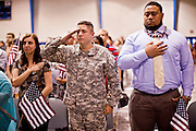 "July 2 - PHOENIX, AZ: Arizona Cardinals' offensive lineman TAITUSI ""Duece"" LATUI,   originally from Tonga, RIGHT, and others are sworn as US citizens Friday. Nearly 200 people were sworn in as US citizens during the ""Fiesta of Independence"" at South Mountain Community College in Phoenix, AZ, Friday. The ceremony is an annual event on th 4th of July weekend and usually the largest naturalization ceremony of the year in the Phoenix area.  Photo by Jack Kurtz"