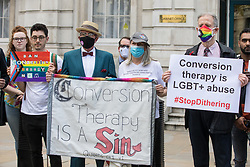 London, UK. 23rd June, 2021. Campaigners against LGBT+ conversion therapy, including veteran LGBT+ and human rights activist Peter Tatchell (r), attend a picket outside the Cabinet Office and Government Equalities Office. They also handed in a petition signed by 7,500 people calling on the government to fulfil its 2018 promise to ban LGBT+ conversion therapy.