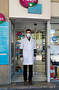 pharmacy shop worker portrait in time of the Covid 19 crisis France April 2020