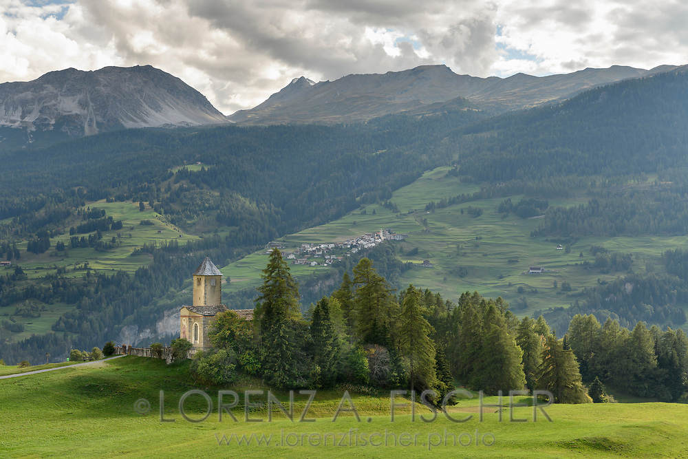 The church St. Maria in Lenz with the Piz Toissa and Curver and the village Stierva, Parc Ela, Grisons, Switzerland