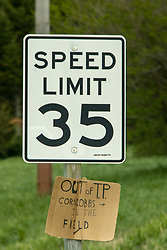 COVID-19: Sign of the times - a speed limit sign in a rural area has an auxiliary sign made of cardboard posted below it directing anyone that is out of TP (toilet paper) to gather corncobs from a nearby field.