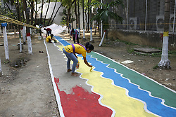 April 13, 2018 - Dhaka, Bangladesh - Artist paints on a rood as they spend busy time for preparing to celebrate coming Bangla New Year on 14 April, at Dhaka University's Faculty of Fine Arts. (Credit Image: © Md. Mehedi Hasan via ZUMA Wire)