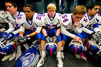 Folsom players sit in the lockerroom before the start of the gema as Grant faces Folsom High School in the Sac-Joaquin Section Division II championship at Hornet Stadium at Sacramento State University, Friday Dec. 3, 2010.