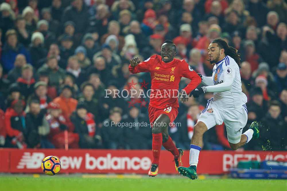 LIVERPOOL, ENGLAND - Saturday, November 26, 2016: Liverpool's Sadio Mane in action against Sunderland's Jason Denayer during the FA Premier League match at Anfield. (Pic by David Rawcliffe/Propaganda)