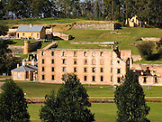 """Port Arthur is a small town and former English prison from 1830-1877 on the Tasman Peninsula, 60 km southeast of Hobart, state capital of Tasmania, Australia. Port Arthur is one of Australia's most significant heritage areas and the open air museum is Tasmania's top tourist attraction. Port Arthur Historic Site was honored in 2010 as part of the Australian Convict Sites on UNESCO's World Heritage List. Penal transportation to Australia from Britain/Ireland occurred 1787-1868 to rid overcrowded prisons of undesirables. In these difficult Dickensian times, inhumane death penalty laws of the """"Bloody Code"""" were falling out of favor for minor offenses and small crimes, and prison populations were swelling in London."""
