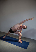 Middle aged man keeping fit with yoga on 29th December 2016, Lagrasse, France.