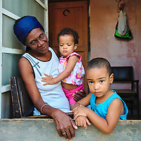 A nanny with the two children at her care at Havana. The two children aren't siblings.