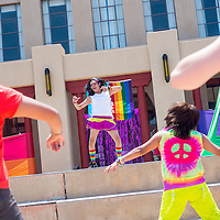 070613       Cable Hoover<br /> <br /> Zoey Kilgore leads a zumba dance during Gallup Pride Fest at the McKinley County Courthouse Square in downtown Gallup Saturday.