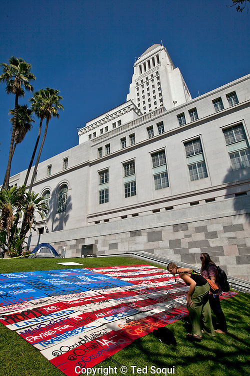 A giant flag made of protest placards on the lawn of LA city hall..Occupy LA day 11. Hundreds of people are camped out on the lawn of LA city hall. Most are protesting against corporate greed and Wall Street.