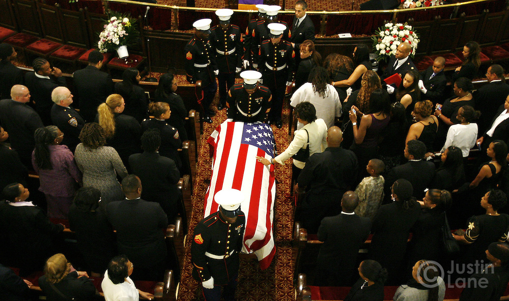 United States Marines carry the casket of United States Marine Lance Cpl. Nicholas J. Whyte at the close of his funeral at the Bedford Central Presbyterian Church in Brooklyn, New York on Friday 30 June 2006. Whyte was killed on 21 June 2006 while serving in Iraq.