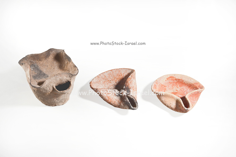 Ancient oil lamps Bronze Age 2000 BCE on the left and two Iron Age terracotta 8-10 century BCE