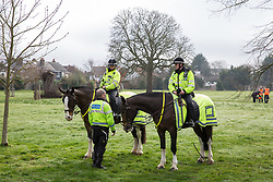 Windsor, UK. 22nd February, 2019. Thames Valley Police deployed around 50 police officers, including mounted police officers, in preparation for a family-friendly protest by around 60 campaigners from Reclaim the Power and Fuel Poverty Action outside the headquarters of Centrica to call on the British multinational energy and services company to cease its support for fracking operations through its partnership with shale gas company Cuadrilla Resources.