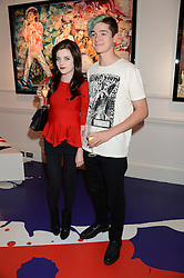 CHARLOTTE WATTS granddaughter of Charlie Watts JACKSON COLLINS at Ronnie Wood's Raw Instinct Summer Party held at Castle Fine Art, Bruton Street, London on 9th July 2013.