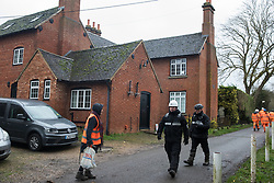 Harefield, UK. 14 January, 2020. HS2 staff and enforcement agents pass in front of a house which will be demolished during works for the high-speed rail link. 108 ancient woodlands are set to be destroyed by the high-speed rail link and further destruction of trees for HS2 in the Harvil Road area is believed to be imminent.
