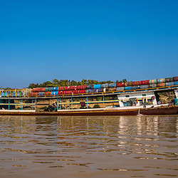 During this dry time of the year, the Chindwin (and the Irrawaddy River) are extremely shallow. Vessel captains hardly find a way through the mushrooming sandbanks. But not only during the monsoon time, public boats regularly take goods and people downstream.<br /> <br /> The Chindwin River is the largest tributary of the Irrawaddy River and originates in the Kachin State of Myanmar and runs south before meeting the Irrawaddy River near the major city (not the capital) Mandalay. Due to low water levels, the Chindwin River is only accessible to larger river vessels during the monsoon season around late July and August and therefore is a much less explored area. Due to the lower number of boats and visitors, the areas around the Chindwin river are peaceful and unspoilt. Most of the river runs through beautiful scenic landscapes, mountain ranges and dense forests.