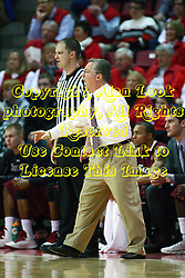 02 February 2013:  Barry Hinson stands next to referee Jeff Malhamduring an NCAA Missouri Valley Conference mens basketball game where the Salukis of Southern Illinois lost to the Illinois State Redbirds for Retro-Night 83-47 in Redbird Arena, Normal IL