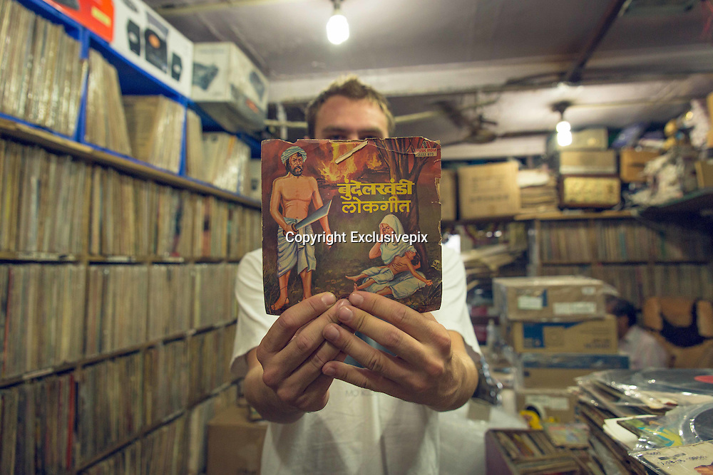 New Delhi's only vinyl record store<br /> <br /> Founded in 1930 in Lahore, Pakistan, New Gramophone House is now the last remaining record shop in Delhi. Relocated to the Indian capital in 1947 following the Indian-Pakistan partition, and nestled above a shoe shop in Delhi's frenetic Chandni Chowk district, the small room houses over one LAKH of records. Once a record shop amongst hundreds of others in Delhi, New Gramophone House now remains the only surviving outlet for vinyl records and has become an institution amongst locals and international collectors alike.<br /> <br /> The current manager, Anuj Rajpal is the son of the previous manager of the shop Ramesh Rajpal who remains ever present in the shop. Ramesh's father was the original founder; New Gramophone House is very much a family affair.<br /> <br /> A tardis of music and a haven for lovers of a bygone musical format, the stacks upon stacks of records make it difficult to know where to begin. With a recording by Lata Mangeshkar on my phone, I played it to the shop assistant and so began my foray in to the depths of New Gramophone House's collection. From religious recordings in Urdu, to Bollywood B Movie soundtracks via snake charmer recordings, this was unlike any record shop experience I've experienced. Beautiful record artwork, stacks of 7 inches, tens of gramophones and an ambivalent manager Anuj Rajpal, reminiscent of Jack Black in High Fidelity, made the experience one that will not be soon forgotten.<br /> <br /> With sales of vinyl increasing for the first time in two decades, New Gramophone House has seen its popularity grow in the last couple of years attaining somewhat of a cult following, thanks to a new generation of music lovers with a keen sense of nostalgia and a love of music from yesteryear.<br /> ©Tom D Morgan/Exclusivepix