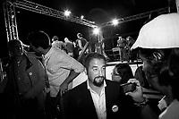 Palermo, Italy, 25 October 2012: Candidate for Governor of Sicily Giancarlo Cacielleri, a 37 years old surveyor from Caltanisetta, is here after the rally supported by founder of the Five Stars Movement Beppe Grillo in Palermo, Italy, on October 25 2012. Beppe Grillo, a comedian turned political guru, Grillo campaigned actively in Sicily, swam across the channel that separates the island from the rest of Italy, scaled its active volcano, Mount Etna, and drawed thousands of Sicilians to campaign rallies for his derisive stand-up routines.<br /> <br /> The direct elections in Sicily for the President of the Region and its representatives will take place on Sunday 28 October 2012, 6 months ahead of the end of the terms of office of the current legislature. The anticipated election of October 28 take place after Raffaele Lombardo, former governor of Sicily since 2008, resigned on July 31st. Raffaele Lombardo is under investigation since 2010 for Mafia ties. His son Toti Lombardo is currently running for a seat in the Sicilian Regional Assembly in the coalition of Gianfranco Micciché, a candidate for the Presidency of the Region. 32 candidates belonging to 8 of the 20 parties running for the Sicilian elections are either under investigation or condemned. ### Palermo, Italia, 25 ottobre 2012: Il Candidato alla Presidenza della Regione Sicilia Giancarlo Cancelleri, un geometra di 37 anni di Caltanisetta, scende dal palco dopo il comizio con il fondatore del Movimento 5 Stelle Beppe Grillo, 64 anni, in Piazza Magione per sostenere il , a Palermo il 25 ottobre 2012.<br /> <br /> Le elezioni in Sicilia per la votazione diretta del presidente della regionee dei deputati all'Assemblea regionale (ARS)si terranno domenica 28 ottobre, in anticipo sulla scadenza naturale dell'attuale legislatura, prevista ad aprile dell'anno prossimo. In Sicilia si vota in anticipo dopo le dimissionidel 31 luglio scorso di Raffaele Lombardo, eletto presidente della regione nell'aprile del 2008 e in