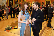 OPHELIA LOVIBOND; CHRISTOPHER DE VOS;, Event hosted by the Dutch Ambasador celebrating the achievements of Dutch and Belgian art and fashion. Wallace Collection. London. 15 February 2011.  -DO NOT ARCHIVE-© Copyright Photograph by Dafydd Jones. 248 Clapham Rd. London SW9 0PZ. Tel 0207 820 0771. www.dafjones.com.