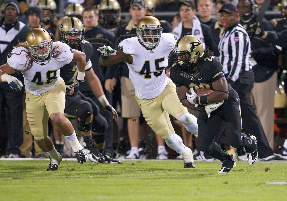 October 01, 2011:  Purdue running back Ralph Bolden (#23) carries the ball as Notre Dame outside linebackers Darius Fleming (#45) and Dan Fox (#48) are in pursuit during NCAA Football game action between the Notre Dame Fighting Irish and the Purdue Boilermakers at Ross-Ade Stadium in West Lafayette, Indiana.  Notre Dame defeated Purdue 38-10.