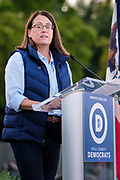 12 SEPTEMBER 2020 - DES MOINES, IOWA: THERESA GREENFIELD, the Democratic candidate for US Senate speaks at the Polk County Democrats Steak Fry in Waterworks Park in Des Moines. The Steak Fry is the largest fundraiser of the year for Polk County Democrats. This year nearly 1,000 people attended. The Steak Fry observed public health guidelines. Normally the Steak Fry is a picnic but this year people stayed in their cars while meals were brought to them and they wore masks when they were outside of the cars. Most of the speakers appeared via online speeches.    PHOTO BY JACK KURTZ