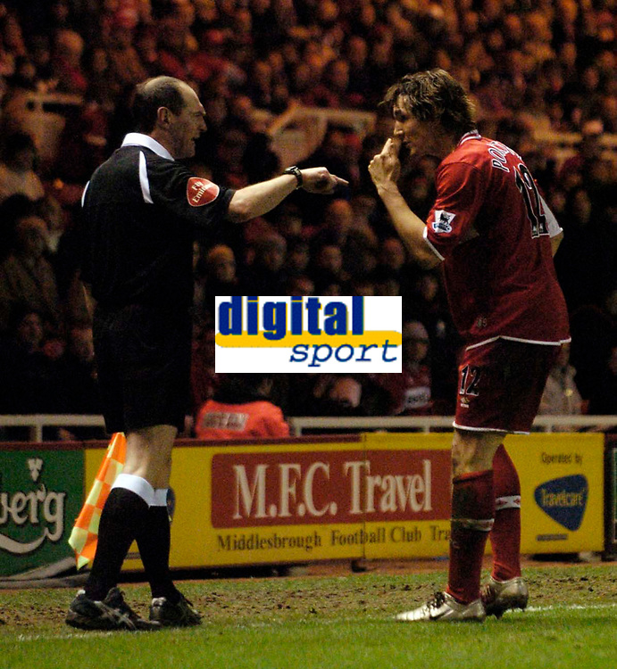 Photo: Jed Wee.<br /> Middlesbrough v Coventry City. The FA Cup. 08/02/2006.<br /> <br /> Middlesbrough's Emanuel Pogatetz (R) is shown a yellow card for insinuating that the referee's assistant needs his eyesight checked.