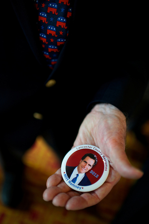 Republican Commitee Lancaster County official Frank Fryburg displays a Mitt Romney pin.  Former Massachusetts Gov. Mitt Romney, a candidate for the Republican presidential nomination, is slated to address the Lancaster County GOP Annual Dinner at the Lancaster County Convention Center in Lancaster, Pa., on April 17, 2012.