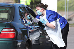 Medical staff taking samples at 10.19am at an NHS drive through coronavirus disease (COVID-19) testing facility at Chessington World of Adventures, in Greater London, as the UK continues in lockdown to help curb the spread of the coronavirus.