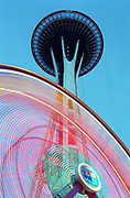The Space Needle, rising behind one of the rides at Seattle Center, was designated a historic landmark in 1999. (Benjamin Benschneider / The Seattle Times, 1999).