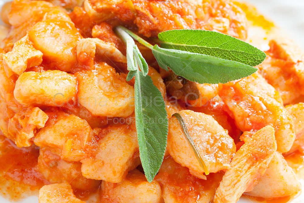 Closeup of plate with pumpkin gnocchi, traditionally Italian pasta with pumpkin.
