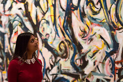 A woman walks past 'Mural', 1943 by Jackson Pollock during a photocall at the Royal Academy of Arts, London.