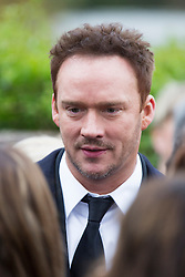 © Licensed to London News Pictures. 03/11/2015. Manchester, UK. Singer Russell Watson at The funeral of Kirsty Howard who was given just weeks to live at the age of four has taken place in Manchester today. Kirsty Howard was one of only two people in the world born with a back-to-front heart. She died on 24 October having spent years raising millions of pounds for Francis House children's hospice in Manchester. Photo credit: Andrew McCaren/LNP
