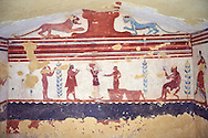 Underground Etruscan tomb  A single chamber with double sloping ceiling. In the tympanium are two wild animals below wich is a scene with a portait of the deceased seated watching a dancer and a flute player. Circa 400 BC, Etruscan Necropolis of Monterozzi, Monte del Calvario, Tarquinia, Italy. A UNESCO World Heritage Site. .<br /> <br /> Visit our ETRUSCAN PHOTO COLLECTIONS for more photos to buy as buy as wall art prints https://funkystock.photoshelter.com/gallery-collection/Pictures-Images-of-Etruscan-Historic-Sites-Art-Artefacts-Antiquities/C0000GgxRXWVMLyc