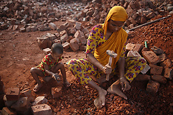 November 3, 2018 - Dhaka, Bangladesh - Koitori (3), a child with her mother Halima (29) breaks bricks at a brick factory in Keraniganj. All age labor work there earn around 20 US dollars per week over eight hours each day as they come from country side in a hope for better life. (Credit Image: © MD Mehedi Hasan/ZUMA Wire)