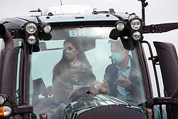 Farmer Stewart Chapman gives the Duchess of Cambridge instructions on how to drive a tractor during a visit to Manor Farm in Little Stainton, Durham. Picture date: Tuesday April 27, 2021.