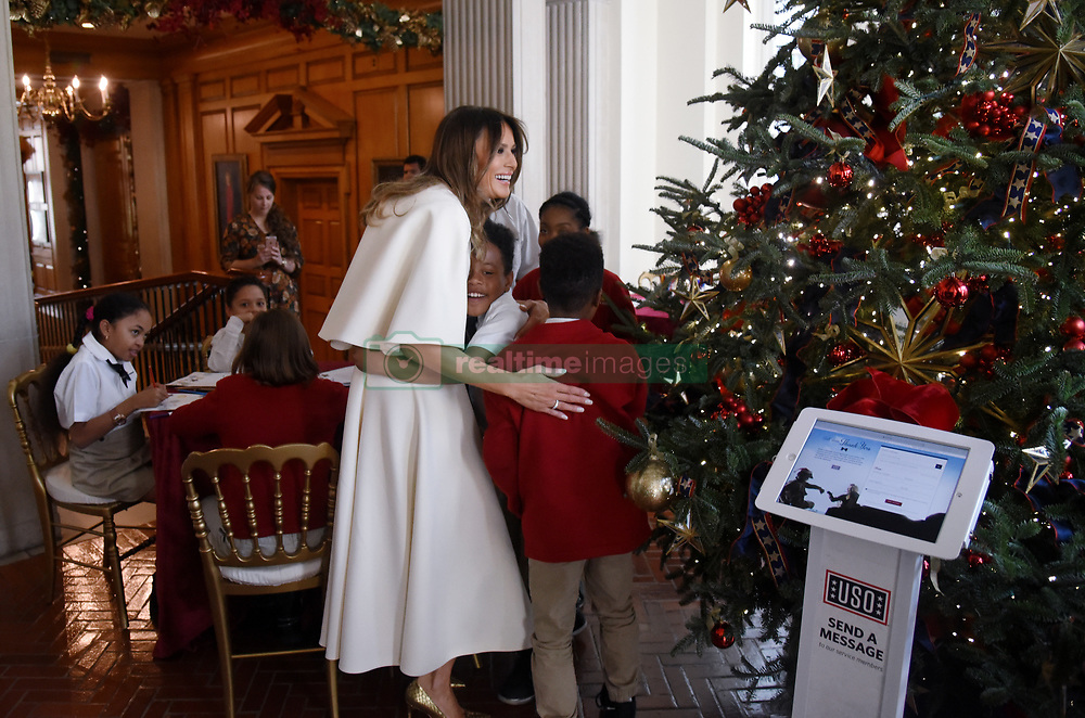 First Lady Melania Trump participates in arts and crafts projects with children and students from Joint Base Andrews in various rooms throughout the White House in Washington, DC, November 27, 2017.Photo by Olivier Douliery/Abaca Press