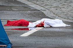 © Licensed to London News Pictures. 02/04/2019. London, UK. Blood soaked clothing lies in the road in Kentish Town, north London, where a man in his 20s was found with fatal stab wounds at 8.30 pm on 1st April.  Another man has been stabbed in Edmonton this morning. Photo credit: Peter Macdiarmid/LNP