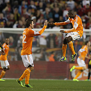 Oscar Boniek García, (right), Houston Dynamo, celebrates with team mate Bobby Boswell after team mate Omar Cummings had scored his sides winner watched by Thierry Henry, (left), New York Red Bulls, during the New York Red Bulls V Houston Dynamo, Major League Soccer second leg of the Eastern Conference Semifinals match at Red Bull Arena, Harrison, New Jersey. USA. 6th November 2013. Photo Tim Clayton