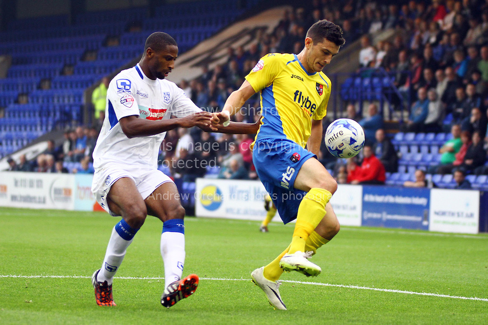 Exeter City's Graham Cummins shields ball from Tranmere Rovers' Clayton McDonald. Skybet football league two match, Tranmere Rovers v Exeter city at Prenton Park in Birkenhead, the Wirral on Saturday 20th Sept 2014.<br /> pic by Chris Stading, Andrew Orchard sports photography.
