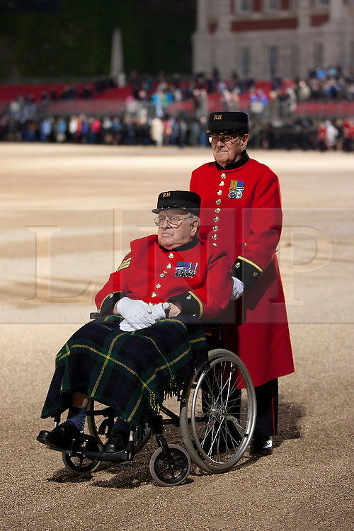 © Licensed to London News Pictures. 13/06/2012. LONDON, UK. Two Chelsea Pensioners wait to leave Horse Guards Parade after the annual Beating Retreat parade. On two successive evenings each year in June a pageant of military music, precision drill and colour takes place on Horse Guards Parade in the heart of London when the Massed Bands of the Household Division carry out the Ceremony of Beating Retreat. 300 musicians, drummers and pipers perform this age-old ceremony. The Retreat has origins in the early days of chivalry when beating or sounding retreat pulled a halt to the days fighting. Photo credit: Matt Cetti-Roberts/LNP