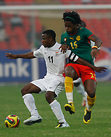 Photo: Steve Bond/Richard Lane Photography.<br /> Cameroun v Zambia. Africa Cup of Nations. 26/01/2008. Alexandre Song (R) closes down Christopher Katongo (L)