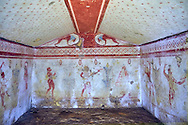 """Underground Etruscan tomb Known as """"Maurio Moretti no 5591"""" A single chamber with double sloping ceiling decorated with flowers. In the tympanium are two lions below which is a flute player, a male figure holding a kylix and a richly dressed female figure. 500-490 BC. Excavated 1968 , Etruscan Necropolis of Monterozzi, Monte del Calvario, Tarquinia, Italy. A UNESCO World Heritage Site. .<br /> <br /> Visit our ETRUSCAN PHOTO COLLECTIONS for more photos to buy as buy as wall art prints https://funkystock.photoshelter.com/gallery-collection/Pictures-Images-of-Etruscan-Historic-Sites-Art-Artefacts-Antiquities/C0000GgxRXWVMLyc"""