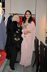 Left to right, LADY COBURN and CARMEN HAID at a dinner hosted by Carmen Haid at Atelier Mayer, 47 Kendal Street, London W2 on 21st February 2012.