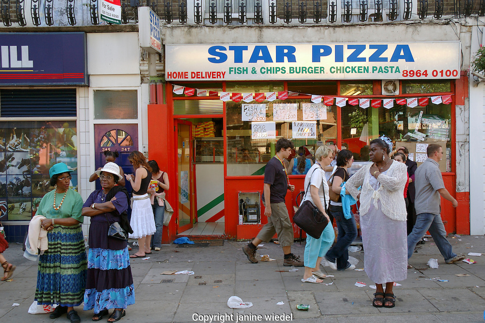 Pizza take away shop in rundown multicultural area of south London.