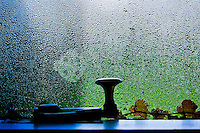 Still life, objects on windowsill against textured glass, Ireland. Fine art photography prints for sale.