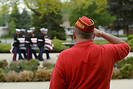 Bob Rader of Cary, Ill., a Korean War veteran and member of the Marine Corps Legion, salutes the casket of Marine Corps Lance Cpl. Jakub Kowalik as an honor guard carries it into St. John Brebuef church for funeral services on Wednesday, May 29, 2003, in Niles, Ill. Kowalik, whose unit was stationed at Camp Pendleton Calif., was killed in Iraq when the ordinance he was handling exploded.  (AP)