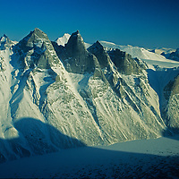 Unnamed Granite spires rise above a fjord on Baffin Island in Canada's Nunavut Territory.