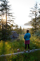 Image of young woman watching sunset in Manzanita, Oregon.