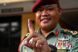 May 5, 2018 - A military officer shows his finger after casting his vote at a polling station during the early voting for general election in Malacca, Malaysia, May 5, 2018. Malaysian police and military personnel casted their votes early on Saturday for the general election to be held in May 9, local media reported. (Credit Image: © Chong Voon Chung/Xinhua via ZUMA Wire)